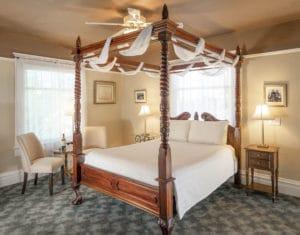 queen bed in Huning Room at Bottger Mansion