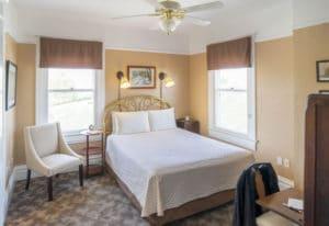 queen bed in Rodey Room at Bottger Mansion