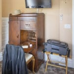 Desk and TV in Rodey Room at Bottger Mansion